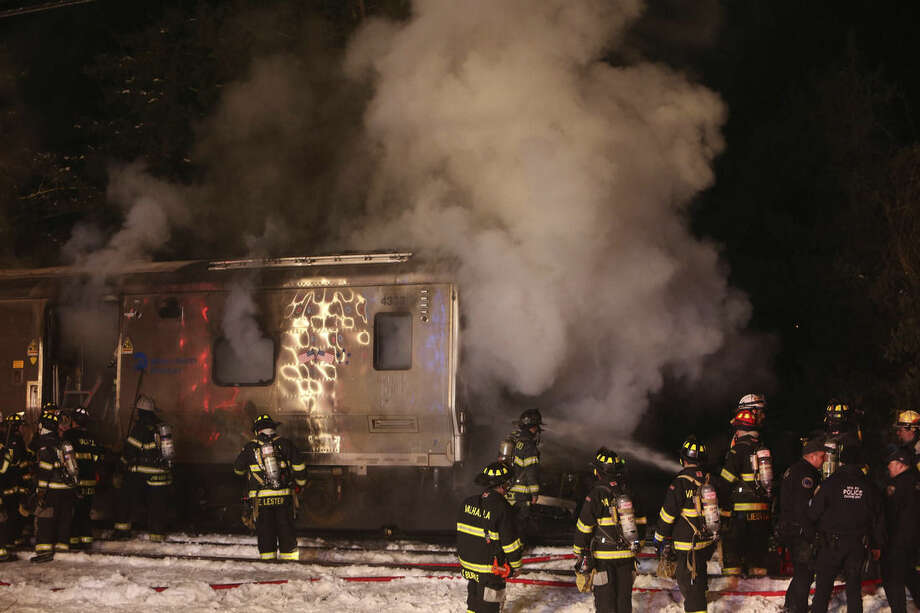 Firefighters work the scene of a collision between a Metro-North Railroad passenger train and a vehicle in Valhalla, N.Y., Tuesday, Feb. 3, 2015. (AP Photo/The Journal-News, Frank Becerra, Jr.) NYC METRO OUT, TV OUT, MAGS OUT, NO SALES
