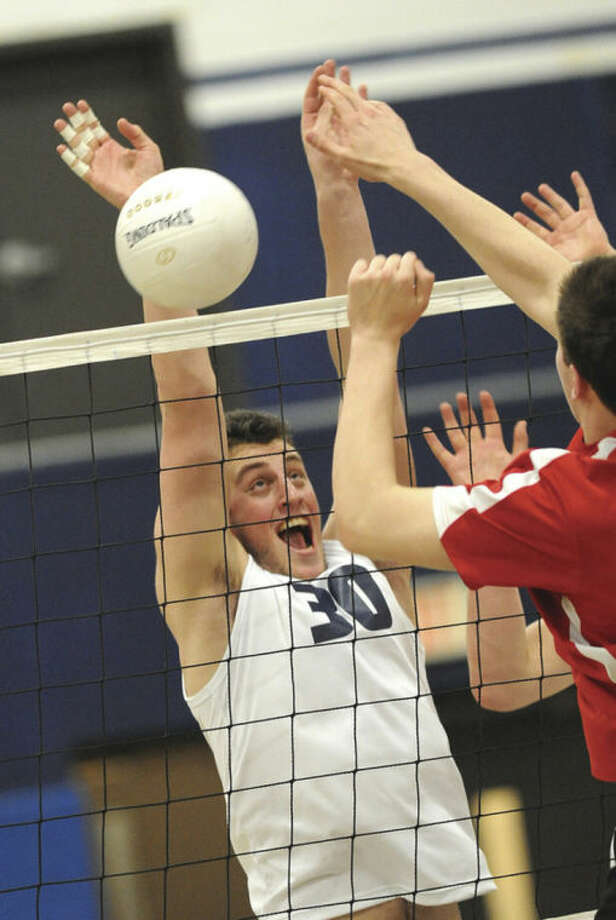 Hour photo/Matthew VinciStaples' Todd Goldstein goes up for a block against Greenwich Monday. The Wreckers won 3-0.