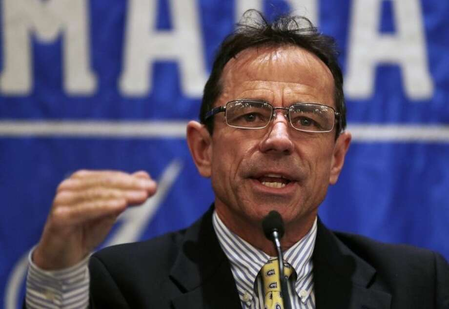 Boston Marathon Race Director Dave McGillivray gestures during a news conference in preparation for the Boston Marathon, Wednesday, April 16, 2014, in Boston. (AP Photo/Charles Krupa)