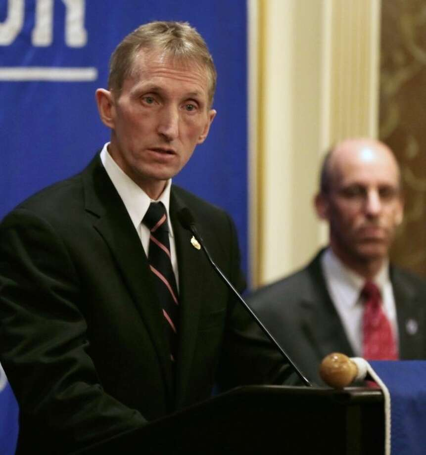 Boston Police Commissioner William Evans speaks during a news conference in preparation for the Boston Marathon as Massachusetts Emergency Management Agency Director Kurt Schwartz, right, listens, Wednesday, April 16, 2014, in Boston. (AP Photo/Charles Krupa)