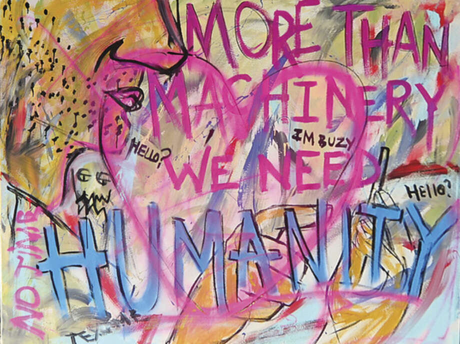 "Hour photo / Erik Trautmann The mysertious graffiti on canvas that hung briefly under the Washington St train bridge and read, ""More Than Machines, We Need Humanity"" in SoNo Tuesday."