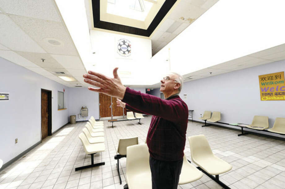 Hour photo / Erik TrautmannSouth Norwalk Community Center Deputy Director Pat Ferrandino speaks about NEON failing to pay utility bills and changes for the building they share.