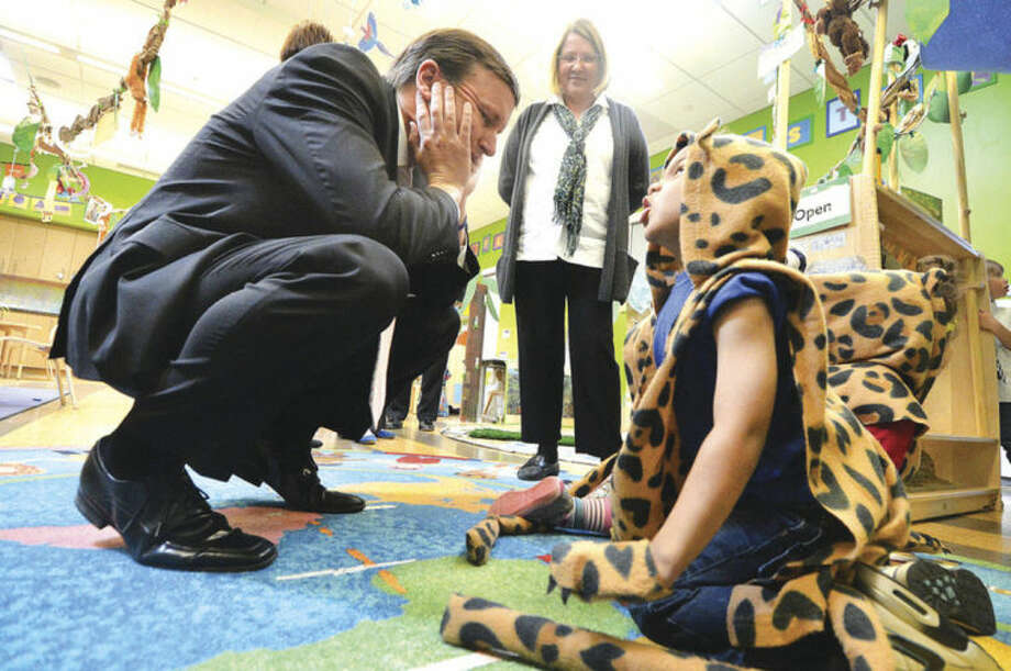 Hour Photo/Alex von Kleydorff Senator Chris Murphy talks with 4yr old Zaire Palmer in a Jaguar costume while visiting the ELLI Lab Preschool at at Stepping Stones Museum for Children