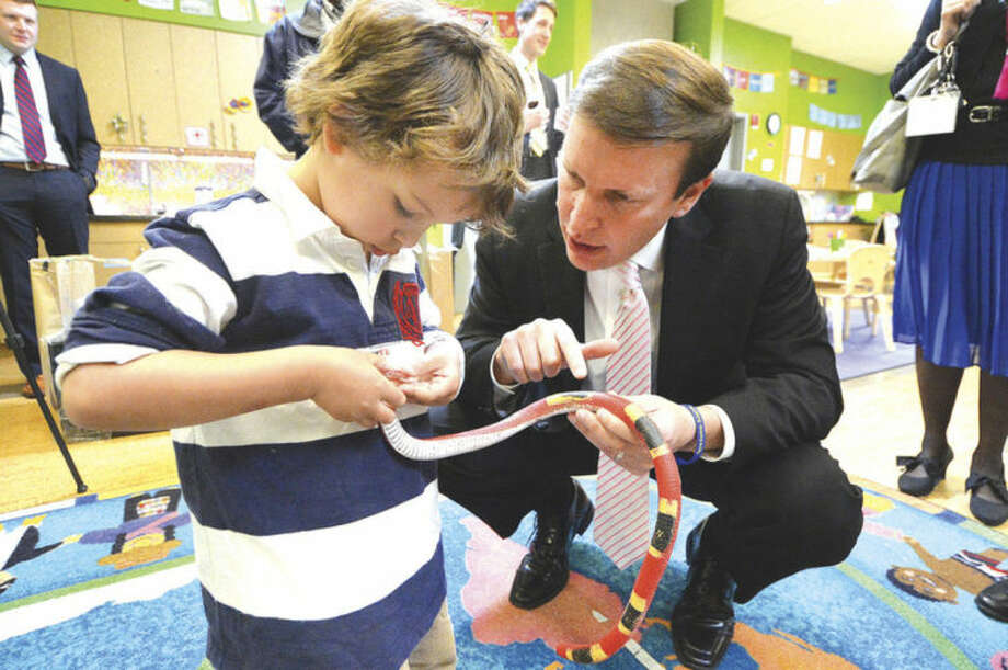Hour photos / Alex von KleydorffSen. Chris Murphy visits with three-year-old Sebastian Ulloa and a rubber snake that's part of the 'Rainforest' in the ELLI Lab Preschool at Stepping Stones Museum for Children on Thursday.