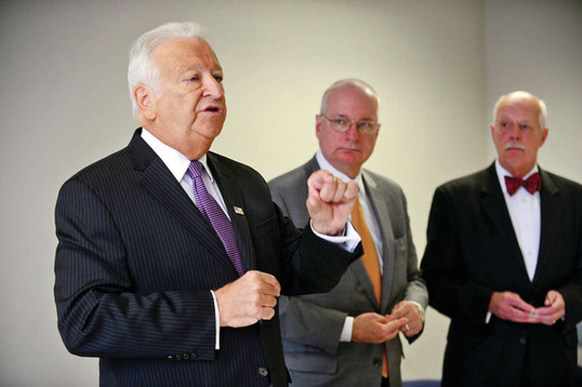 Hour photo / Erik Trautmann Mayor Richard A. Moccia holds a press conference Tuesday with corporation counsel Robert Maslan and Business Director Tad Diesel to outline the city's response to the situation at NEON.