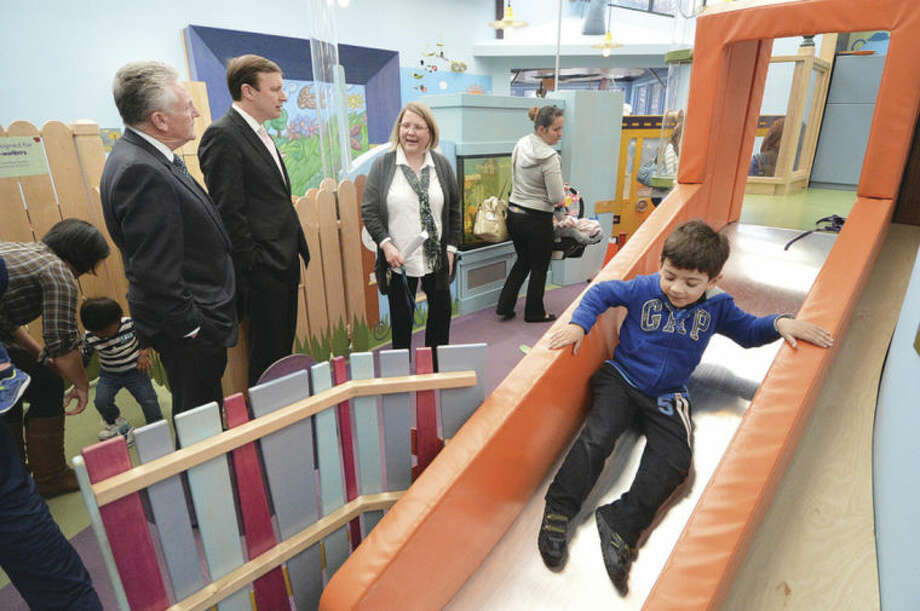 Hour Photo/Alex von Kleydorff Stepping Stones Museum for Children President and CEO Rhonda Kiest shows Sen Chris Murphy and Mayor Harry Rilling some of the attractions inside the Museum on Thursday