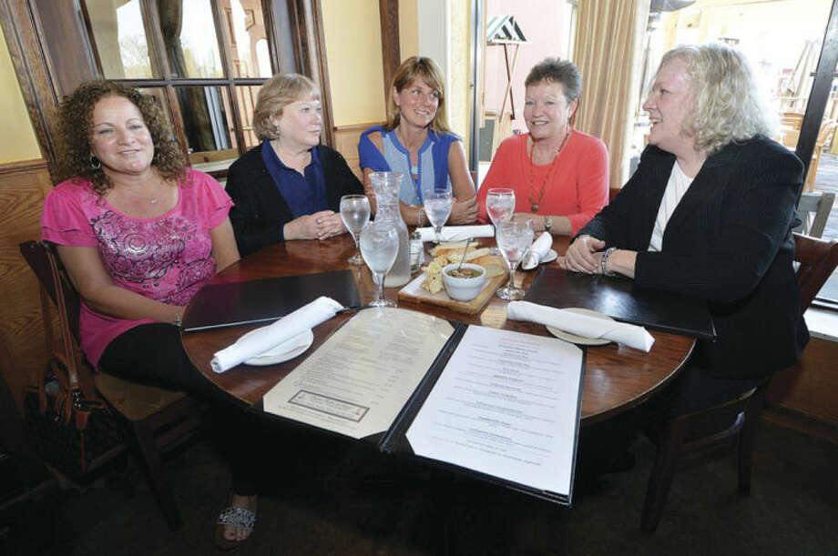 Hour Photo/Alex von KleydorffFive former local soccer moms still get together for dinner on a regular basis even though it's been nearly two decades since their sons played in the NJSA. From left-to-right: Sharon O'Hara, Patty DePaoli, Kathy Mitchell, Debbie Beierle and Marty Scully.