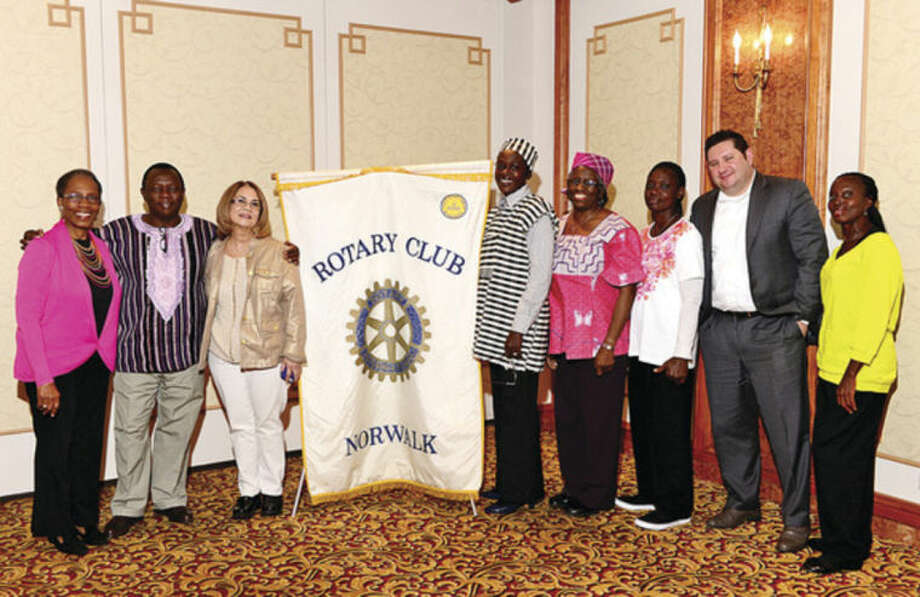 Hour photo / Erik Trautmann Dr. Cynthia Barnett, Sierra Leone teacher Rashid Turay, Joan Parris, Sierra Leone teacher Famata Rhida, Sierra Leone teacher Audrey Pabs-Garnon, Sierra Leone teacher Jestina Rowe, President of Norwalk Rotary Brian Falkowski and Sierra Leone teacher Elizabeth Knox at a recent Rotary luncheon.The Norwalk Rotary VTT exchange program invited teachers from Sierra Leone to Norwalk after Dr. Cynthia Barnett and Joan Parris, who are part of a team of early childhood development educators from our area, traveled to Sierra Leone earlier this year.