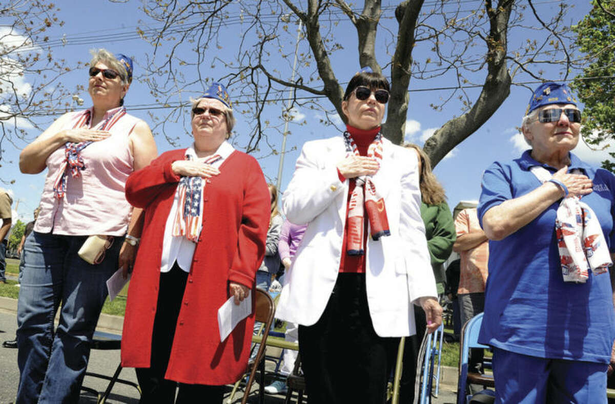 Hour photos / Matthew Vinci Members of the Norwalk VFW Auxillary, Joan Thant, Lynne Renzulli, Carol Jacobson and Marge Grindstaff at the the Shea-Magrath Memorial Ceremony Sunday at Calf Pasture Beach.