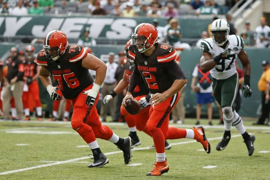 Cleveland Browns guard Joel Bitonio (75) blocks for quarterback Johnny Manziel (2) as New York Jets' Calvin Pace (97) chases the play during the second half of an NFL football game Sunday, Sept. 13, 2015 in East Rutherford, N.J. (AP Photo/Jason DeCrow)