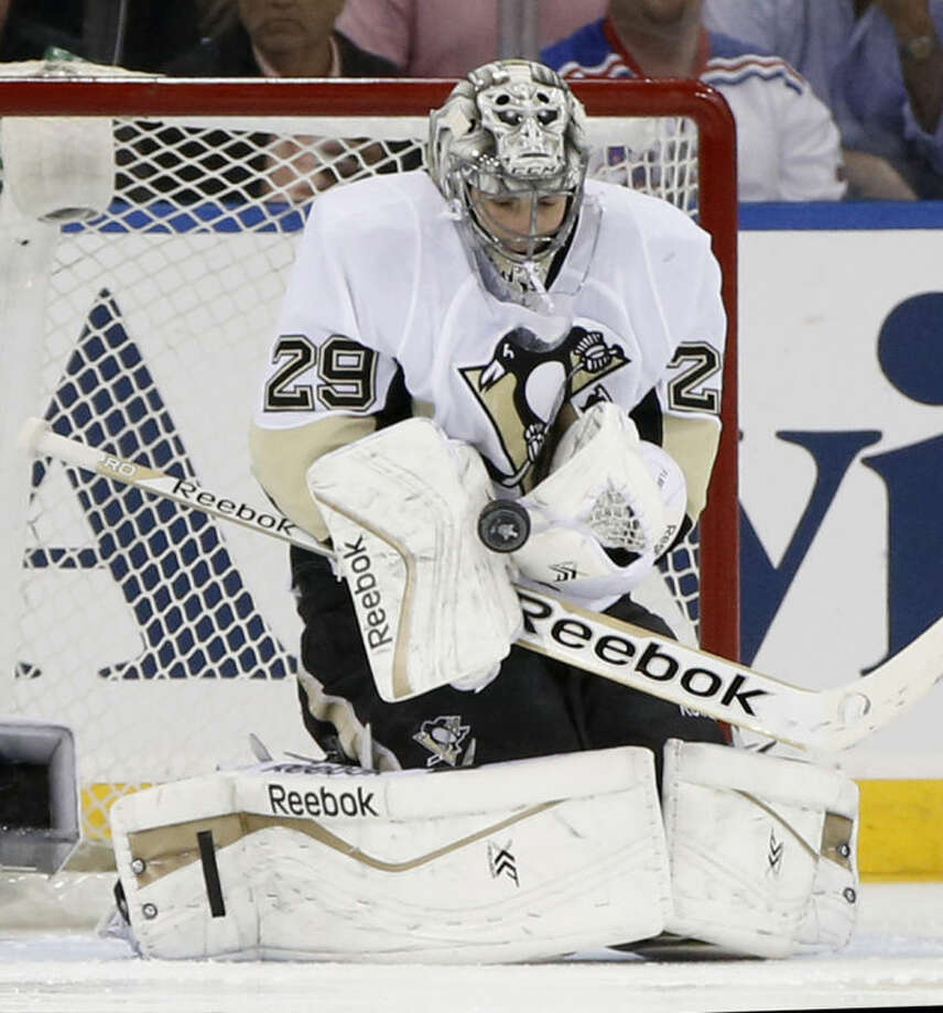 Pittsburgh Penguins goalie Marc-Andre Fleury (29) makes a save in the first period of their second-round NHL Stanley Cup hockey playoff game at Madison Square Garden in New York, Monday, May 5, 2014. (AP Photo/Kathy Willens)