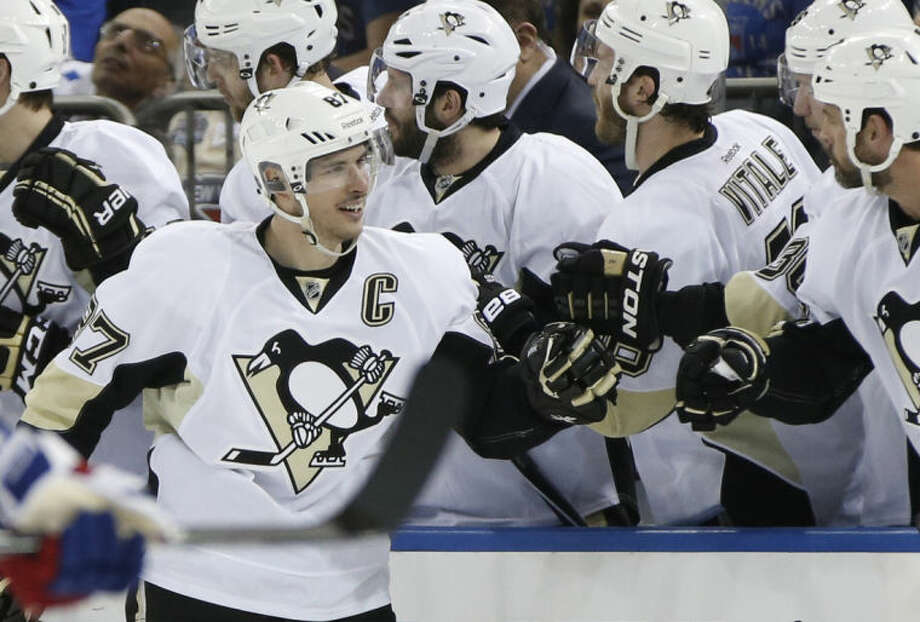 Teammates congratulate Pittsburgh Penguins center Sidney Crosby (87) who scored his first goal of the playoffs in the second period of a second-round NHL Stanley Cup hockey playoff game against the New York Rangers at Madison Square Garden in New York, Monday, May 5, 2014. (AP Photo/Kathy Willens)