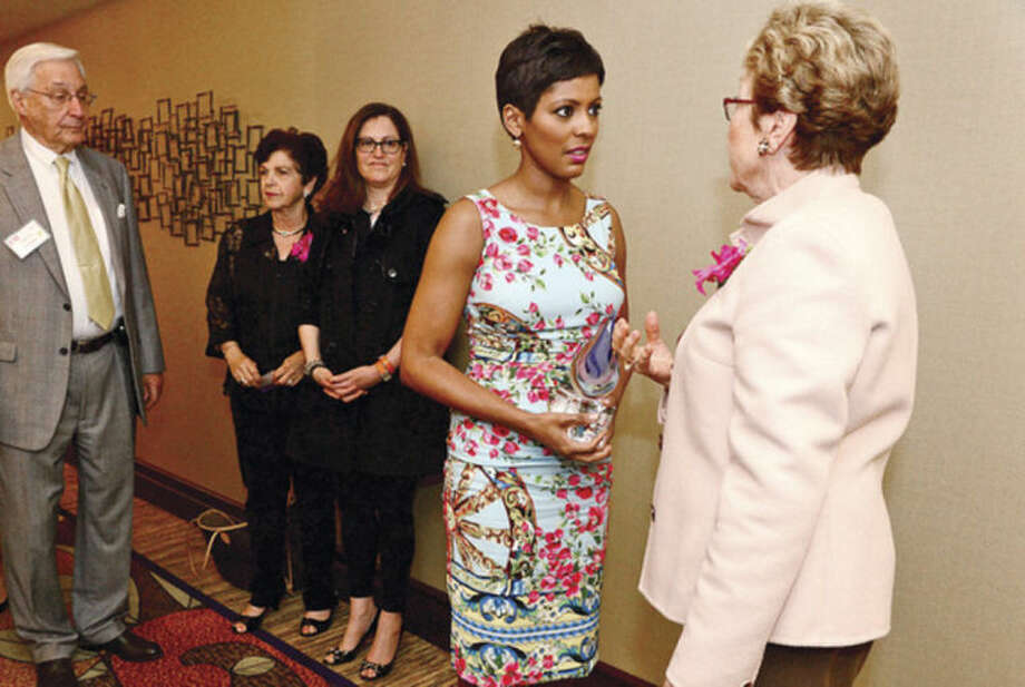 Hour photo / Erik Trautmann Tamron Hall, a co-host on NBC's TODAY show and host of MSNBC's NewsNation, chats with Stam,ford resident Pat Phillips after Hall was honored at the Domestic Violence Crisis Center's 12th annual Voices of Courage Spring Luncheon at the Stamford Marriott Hotel Thursday.