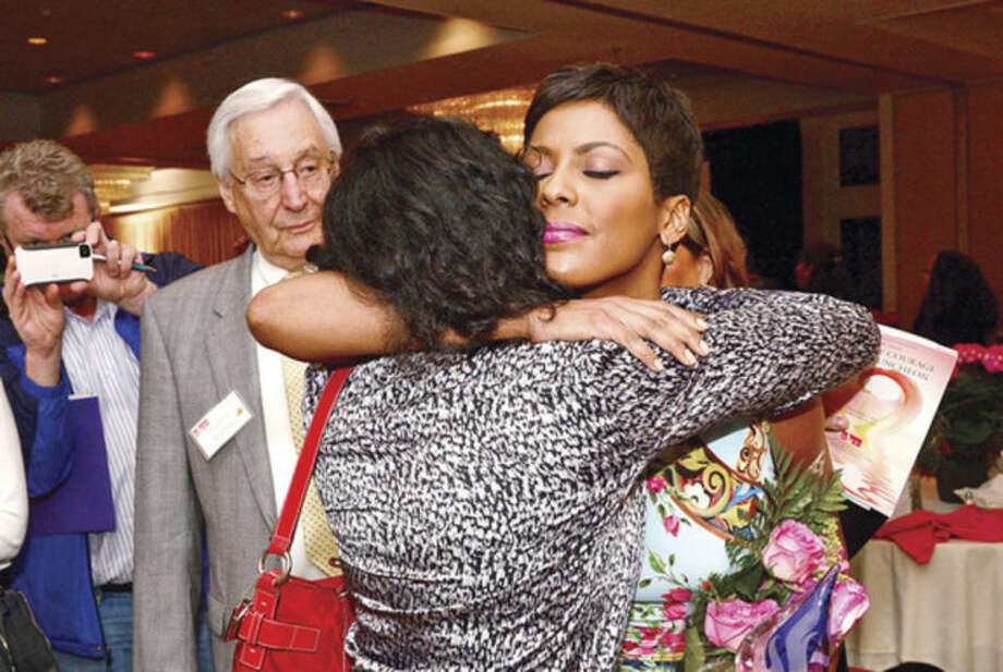 Hour photo / Erik Trautmann Tamron Hall, a co-host on NBC's TODAY show and host of MSNBC's NewsNation, shares a moment with Norwalk resident Anna Duleep after Hall was honored at the Domestic Violence Crisis Center's 12th annual Voices of Courage Spring Luncheon at the Stamford Marriott Hotel Thursday.