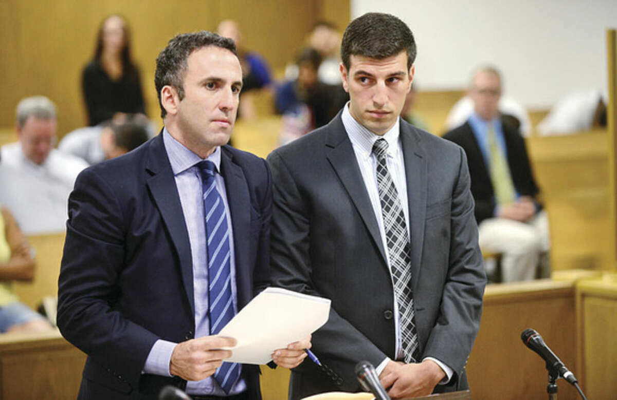 Hour photo / Erik Trautmann Attorney Mark Sherman and his client Brien McMahon High School teacher, David Marchetti, appear in Norwalk Superior Court Wednesday for Marchetti's arraignment on charges of voyeurism of his students.
