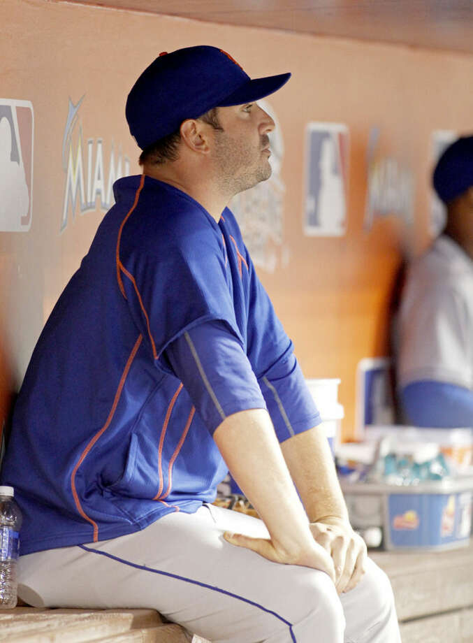 New York Mets pitcher Matt Harvey watches play from the dugout in the eighth inning during the Mets' 7-0 win over the Miami Marlins during a baseball game in Miami, Saturday, Sept. 5, 2015. (AP Photo/Joe Skipper)