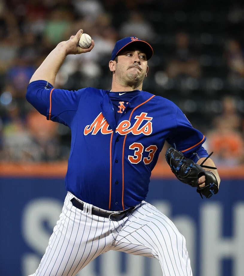 New York Mets starting pitcher Matt Harvey throws against the Philadelphia Phillies during the first inning of a baseball game Wednesday, Sept. 2, 2015, in New York. (AP Photo/Kathy Kmonicek)