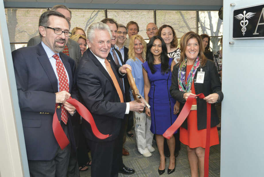 Hour Photo/Alex von Kleydorff Advanced Specialty Care President Dr Jay Klarsfeld MD., Mayor Harry Rilling and COO Dana Lamdert cut the ribbon on the new space at 488 Main Ave in Norwalk