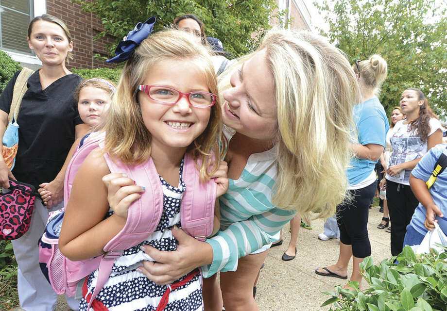 Hour photo/Alex von KleydorffSix-year-old Allison Pennella gets a hug from her mother, Sara, as she prepares to enter first grade at Columbus Magnet School on Monday.