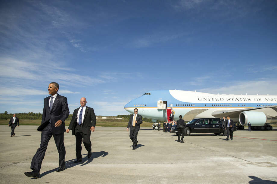 President Barack Obama walks to greet visitors after arriving at Elmendorf Air Force Base, Monday, Aug. 31, 2015, in Anchorage, Alaska. Obama opens a historic three-day trip to Alaska aimed at showing solidarity with a state often overlooked by Washington, while using its glorious but changing landscape as an urgent call to action on climate change. (AP Photo/Andrew Harnik)