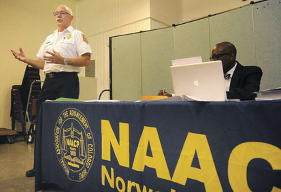 Hour photo/Matthew VinciNorwalk Fire Chief Denis McCarthy speaks to the NAACP meeting Tuesday about recruiting minorities at Calvary Baptist Church.