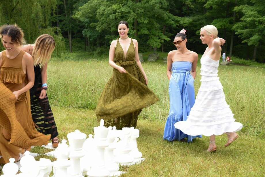 The Philip Johnson Glass House held its annual Summer Party in New  Canaan on June 11, 2016. The event featured a picnic by Schoolhouse at  Cannondale in Wilton, music by DJ Mia Moretti, classic lawn games like  chess and ping-pong and art collections on view. Were you SEEN? Photo: Contributed/Sandra Hamburg