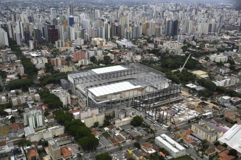 FILE - This Dec. 14 2013 file photo shows an aerial view of the Arena da Baixada stadium in Curitiba, Brazil. Brazilian authorities are pushing for this stadium to be finished in time for the 2014 World Cup soccer tournament. (AP Photo/Renata Brito, File)