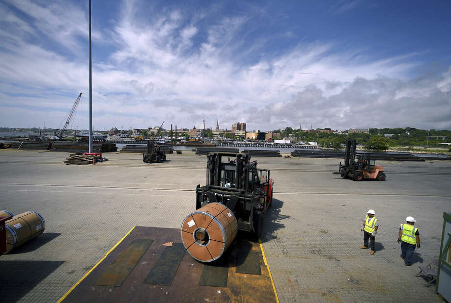 In this July 14, 2015 photo, workers load steel coil onto a forklift from the cargo ship Selinda at the Logistec USA terminal at the Adm. Harold E. Shear State Pier in New London, Conn. The Connecticut Port Authority, which came into existence earlier in July, will be responsible for promoting the state's three deepwater ports: New London, Bridgeport and New Haven. (Tim Cook/The Day via AP) MANDATORY CREDIT