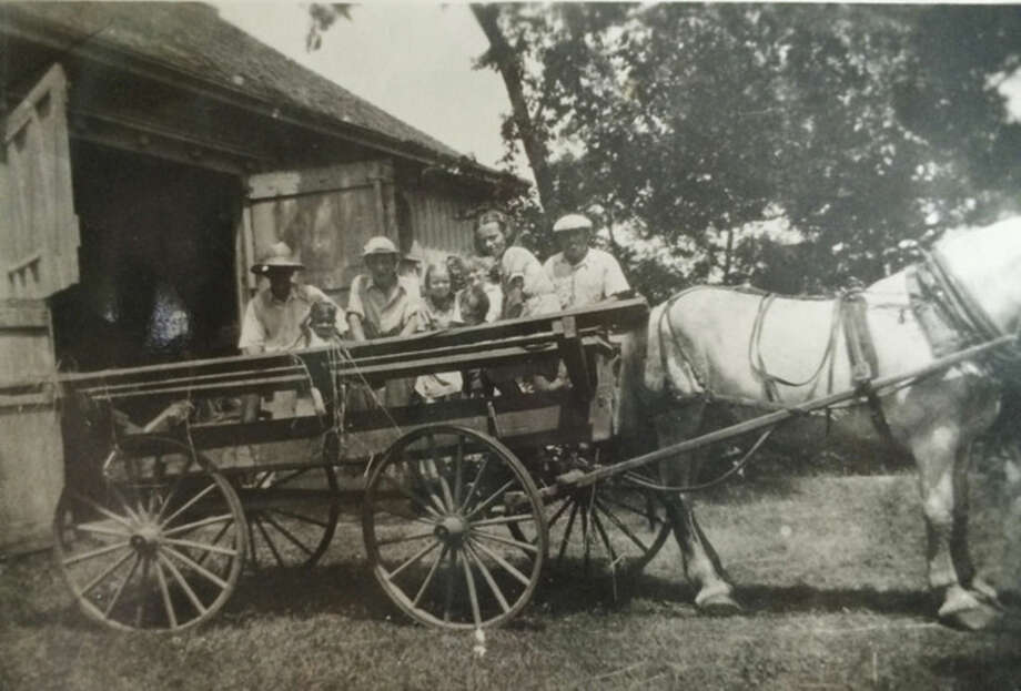 Photo courtesy of Dolores Hallacy MeehanJoe, the estate work horse, with the family in the wagon.