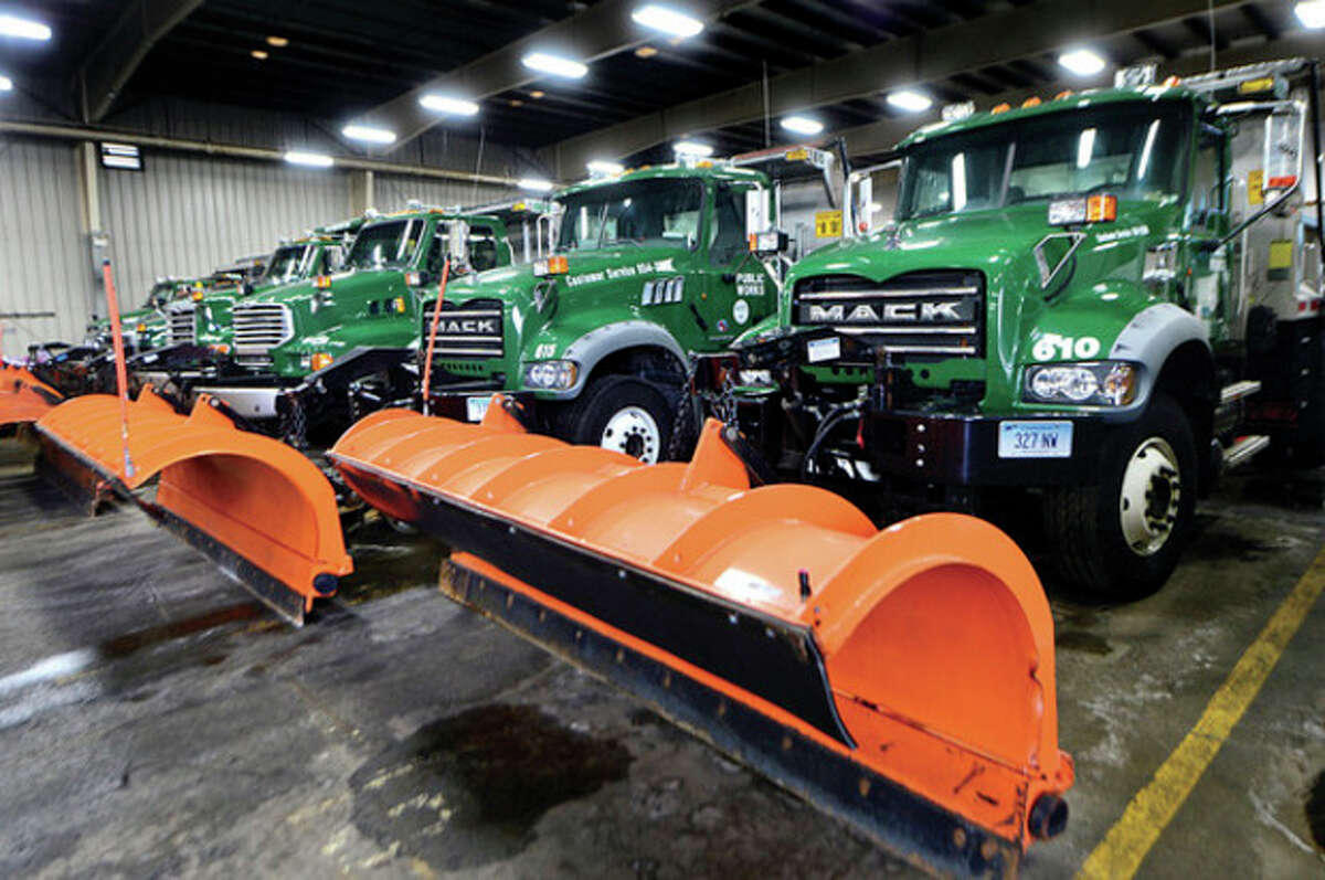 Hour photo / Erik Trautmann Department of Public Works officials outlined snow-removal technology at press conference at Public Works Center at 15 South Smith St. Wednesday.