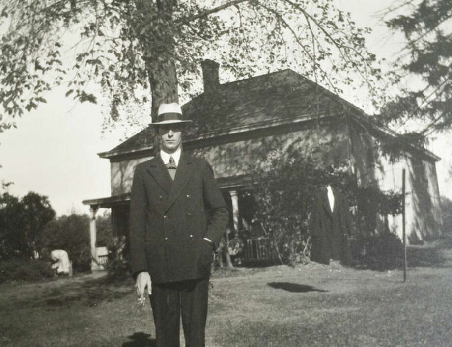 Photo courtesy of Dolores Hallacy MeehanDolores's father in front of the Farrell Home.