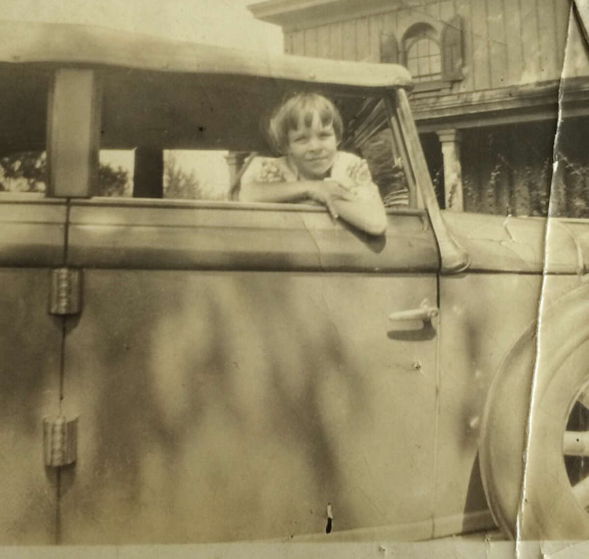 Photo courtesy of Dolores Hallacy Meehan Dolores Hallacy in the estate's truck in front of the cottage and hay barn.