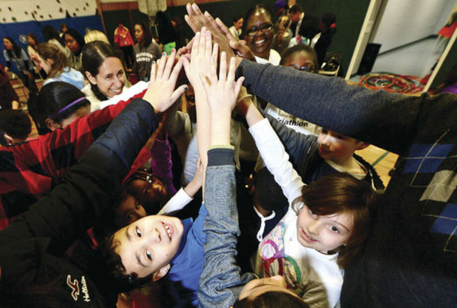 Hour photo / Erik Trautmann Students Jonsel Mercado and Jacqueline Gibson join their schoolmates in the Columbus Magnet School's annual Peace Games to honor Martin Luther King Jr. Friday.