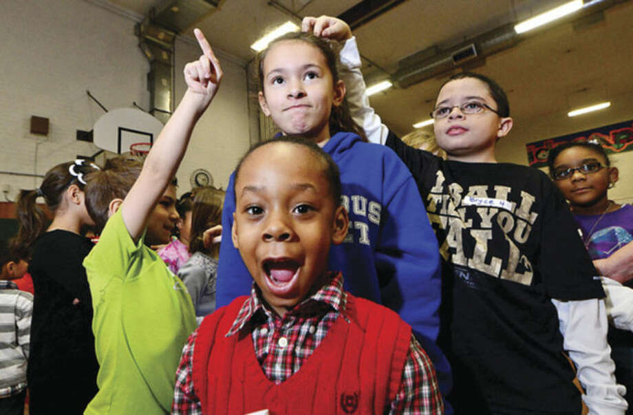 Hour photo / Erik Trautmann J'Monie Bolling and her schoolmates participate in the Columbus Magnet School's annual Peace Games to honor Martin Luther King Jr. Friday.