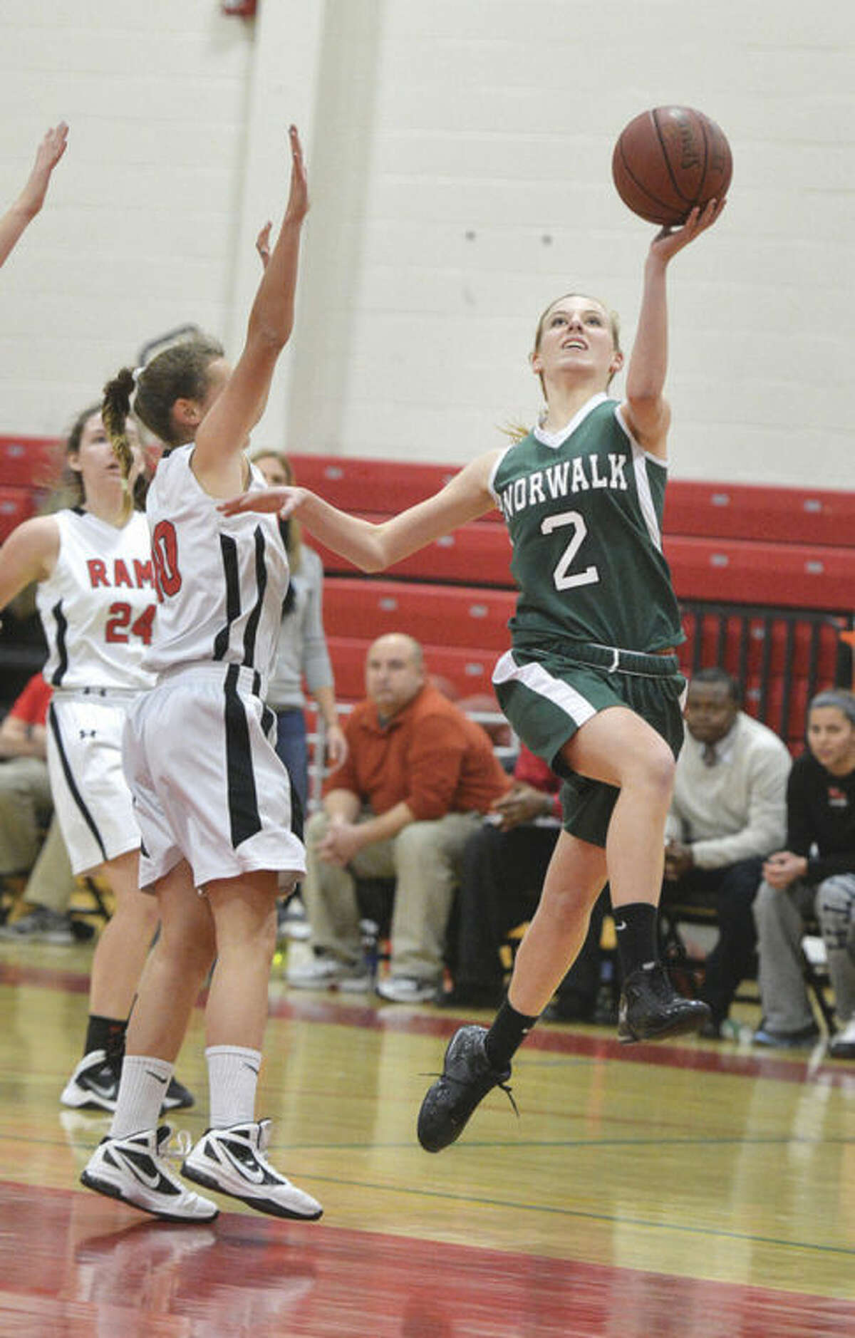 Hour photo/Alex von Kleydorff Norwalk's Amanda Beckwith (2) drives to the hoop during Friday's game against New Canaan at the NCHS gym.