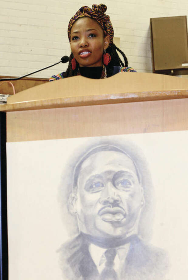Hour photo / Erik Trautmann Tsholo Mokubung speaks of memories of Nelson Mandela who was also honored during the Columbus Magnet School's annual Peace Games that honoe the legacy of Martin Luther King Jr. Friday.