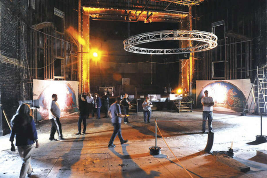 The Wall Street Theater under contsrtuction has a tour of the inside performance area Sunday at the street festival celebrating the 100th anniversary of the theater. Hour photo/Matthew Vinci