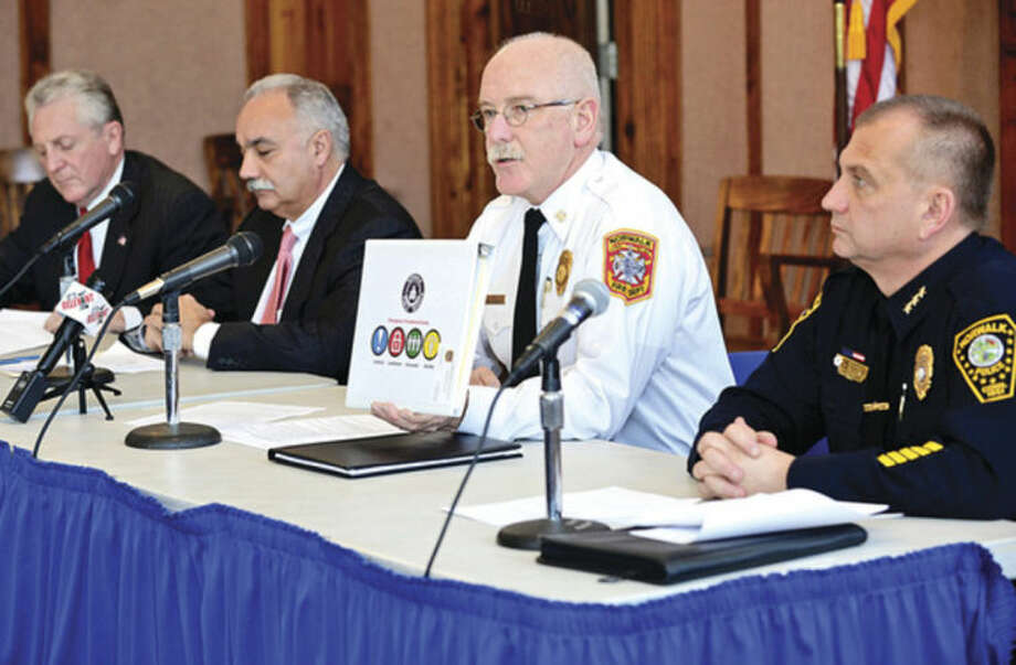 Hour photo / Erik Trautmann City and schools officials, including Norwalk Fire Chief Denis McCarthy, give an overview on initatives the district safety committee has put in place over the last year.