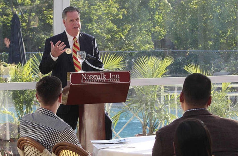 Hour photo/Chris BosakEdward Musante Jr., president and CEO of the Greater Norwalk Chamber of Commerce, talks during the Chamber's New Member Reception held Thursday evening at Norwalk Inn.