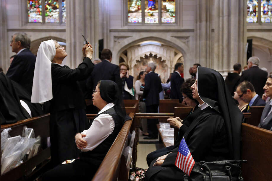 A group of nuns waits inside St. Patrick's Cathedral for Pope Francis to lead an evening prayer service, Thursday, Sept. 24, 2015, in New York. (AP Photo/Jason DeCrow)