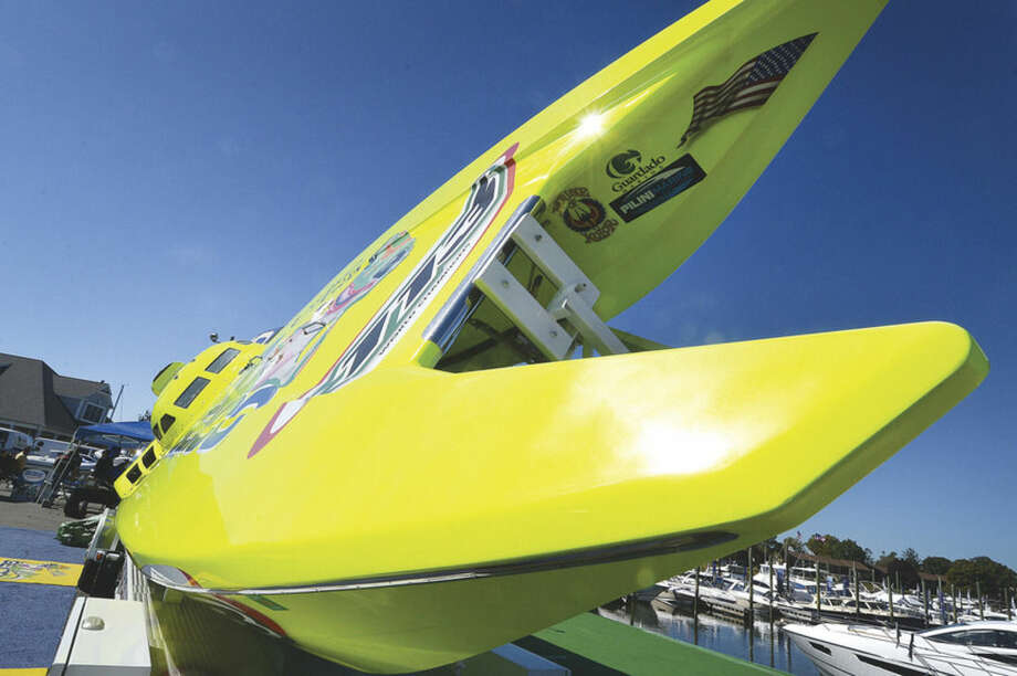 Hour Photo/Alex von Kleydorff Tilted for better viewing, the 4th generation 3000 plus horsepower Miss Geico Offshore Racing Boat, at The Norwalk Boat Show at Cove Marina this Saturday and Sunday