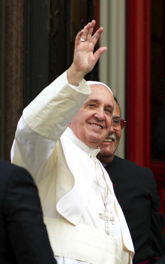 Pope Francis waves to the crowd upon his arrival at St. Patrick's Church in Washington, Thursday, Sept. 24, 2015, following his address to a joint meeting of Congress on Capitol Hill. ( AP Photo/Jose Luis Magana)