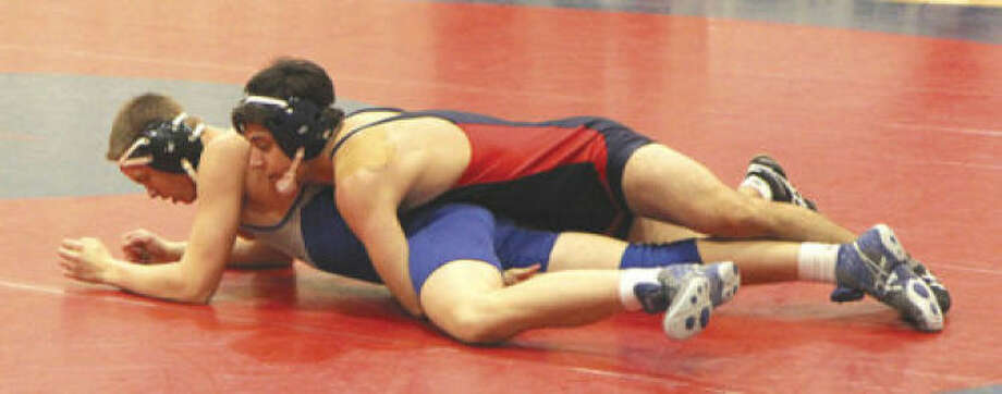 Contributed photoGreens Farms Academy's Jad Qaddourah, top, tries to turn an opponent onto his back during a recent match. The 152-pounder is undefeated in FAA action, and battled his way to the finals at the Shelton tournament.