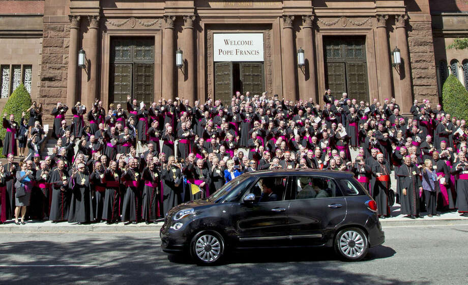 Pope Francis leaves St. Mathews Cathedral in his Fiat 500 after a midday prayer service in Washington, Wednesday, Sept. 23, 2015, as bishops applaud. ( AP Photo/Jose Luis Magana)