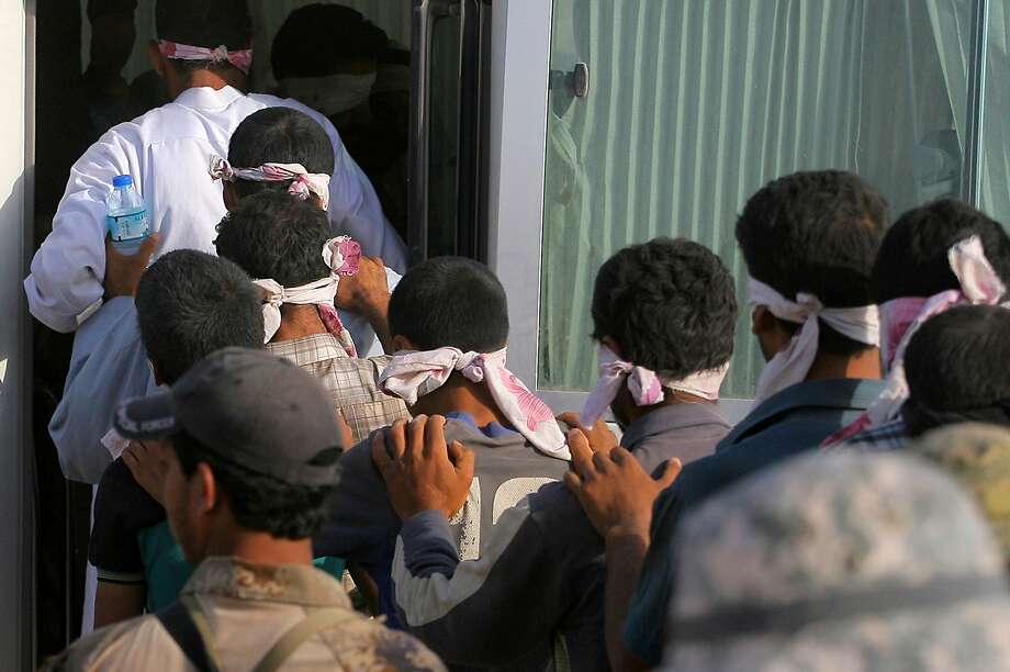 Blindfolded men are detained during the military operation to regain control of the Iraqi city of Fallujah. Photo: Anmar Khalil, Associated Press