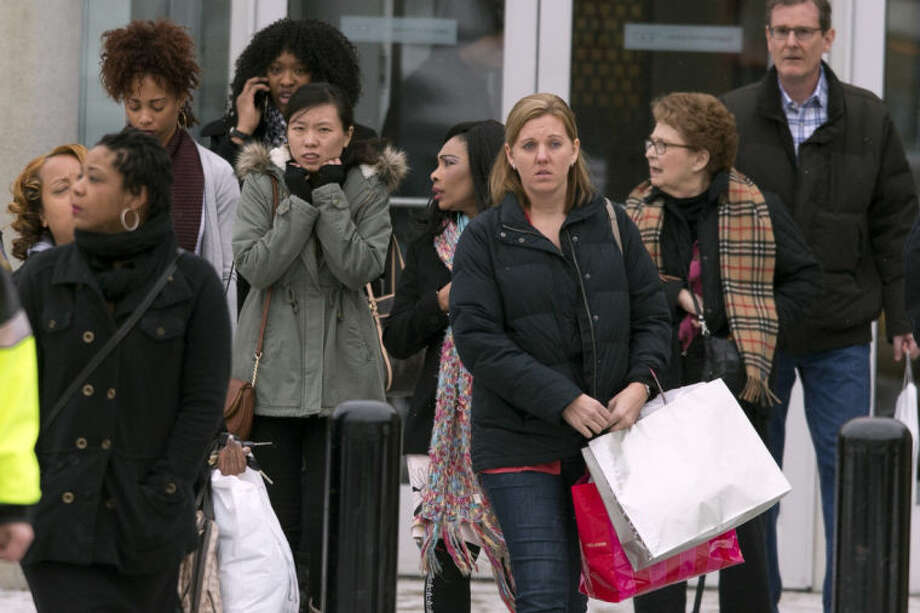 Shoppers are evacuated by police after a shooting at The Mall in Columbia on Saturday, Jan. 25, 2014, in Columbia, Md. Police say three people died in a shooting at the mall in suburban Baltimore, including the presumed gunman. (AP Photo/ Evan Vucci)