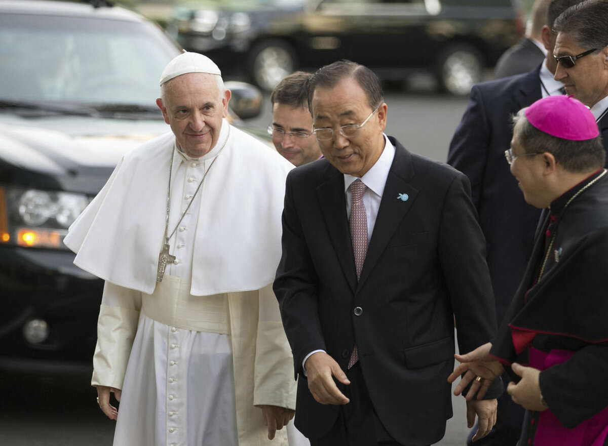 Pope Francis arrives in front of United Nations headquarters with Secretary General Ban Ki-moon Friday, Sept. 25, 2015. (AP Photo/Kevin Hagen, Pool)
