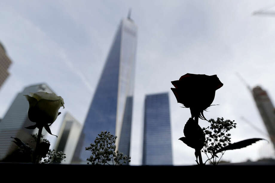 Roses placed by the mother of an architect who died during the Sept. 11, 2001 terrorists attacks are erected off his name on the edge of the South Pool at the site of the World Trade Center in New York, Friday, Sept. 25, 2015. Pope Francis is expected to visit the 9/11 memorial as part of his five-day trip to the United States. (AP Photo/Julio Cortez, Pool)