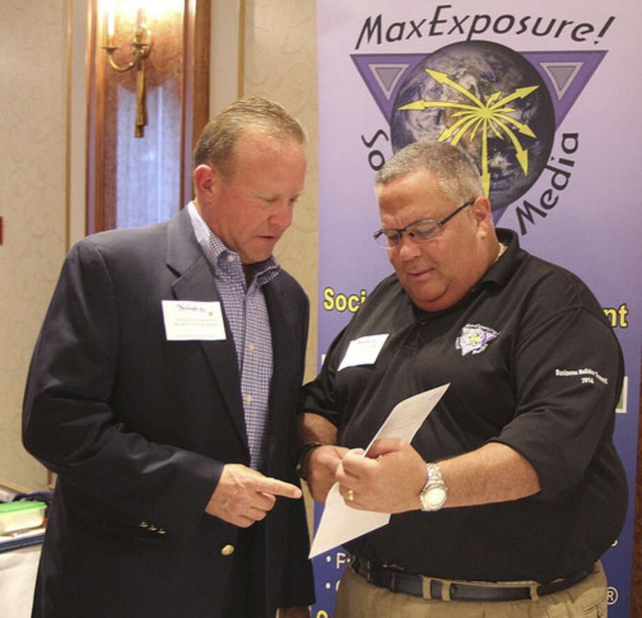 Hour photo/Chris BosakJoe Grushkin with MaxExposure Social Media talks about his business at the Greater Norwalk Chamber of Commerce's New Member Reception Thursday at Norwalk Inn.
