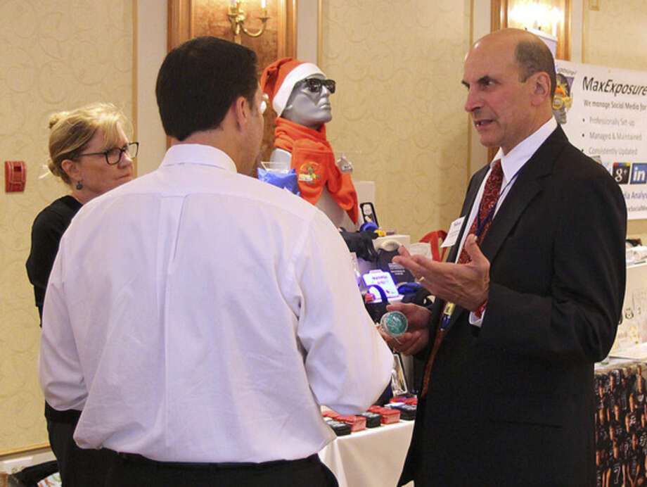 Photo by Chris BosakHoward Greenberg of HLG Promotion Plus, a Westport-based business, talks about his business at the Greater Norwalk Chamber of Commerce's New Member Reception held Thursday evening at Norwalk Inn.
